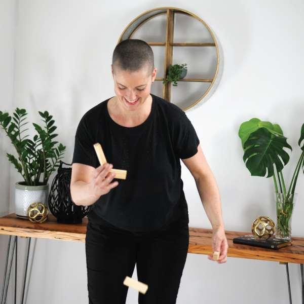 yvette balancing wood blocks that are falling